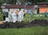 Photo of Personel Kikav 12/MDC Makamkan Jenazah Pasien Reaktif